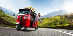 Happy woman travel by traditional srilankan transport, road near tea plantation in srilanka
