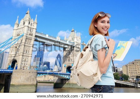 Happy woman travel in London with tower bridge, and smile to you, caucasian beauty #270942971