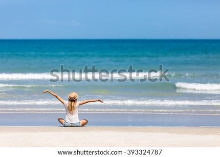 happy woman traveler admiring...