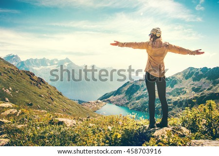 Happy Woman Traveler raised hands mountains and lake landscape on background Travel Lifestyle concept adventure summer vacations