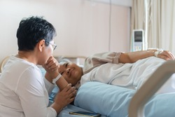 Happy Woman Visits Best friends holding hands for recovering that sick lying in Hospital, looking with cheerful love hopeful emotional, Encouragement comforting Recovering from family healthy moment.