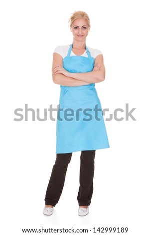 Happy Woman Wearing Kitchen Apron Over White Background