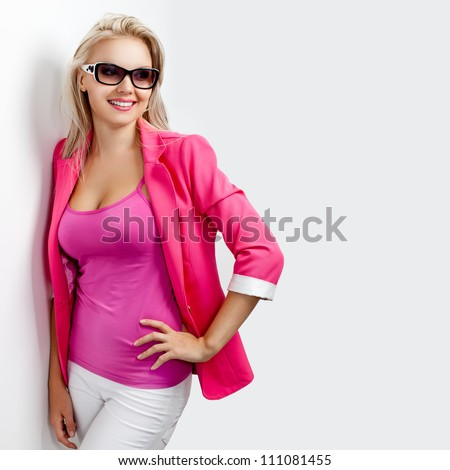 happy woman wearing sunglasses and pink jacket