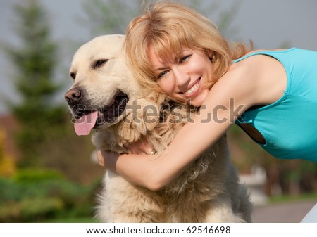 happy woman with a dog - stock photo