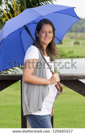 Happy Woman With An Umbrella Outdoor Walking through the meadow
