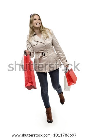 Happy woman with bags on shopping tour #1011786697