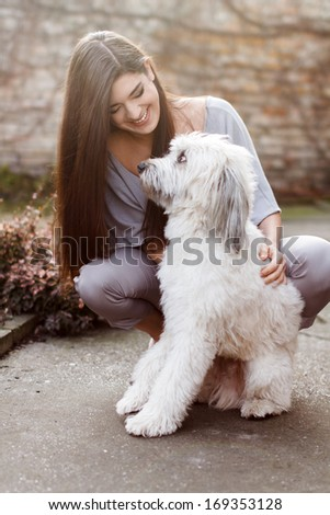 Happy woman with dog, outdoor