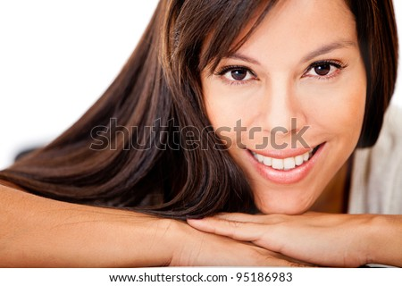 Happy woman with gorgeous long hair - isolated over a white background