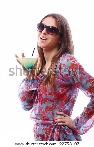 Happy woman with green cocktail over white background