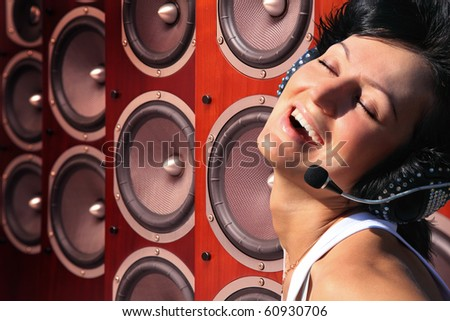 happy woman with headphones and music Audio speakers collage - stock photo