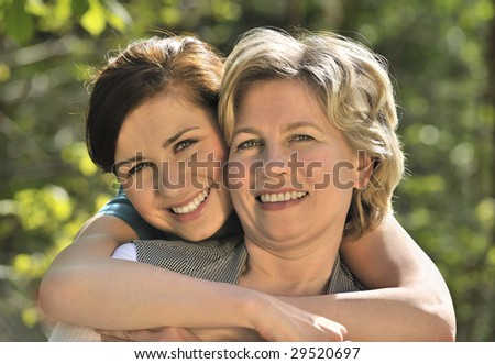 happy woman with her daughter outdoors