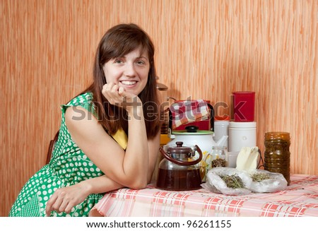 Happy woman with  herbs at home kitchen