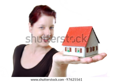 happy woman with miniature house - stock photo
