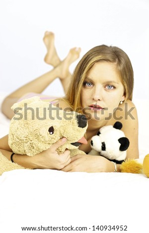 Happy woman with panda and dog stuffed animals
