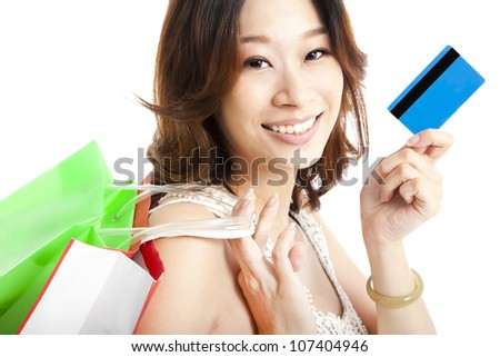 happy  woman with shopping bag and credit card