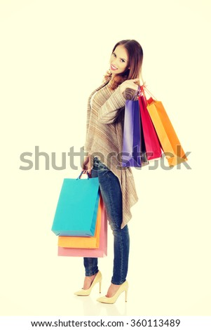 Happy woman with shopping bags. #360113489