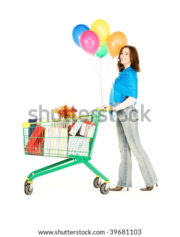 happy woman with shopping cart and balloons over white