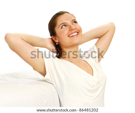 Happy woman with stretched arms sitting on couch isolated