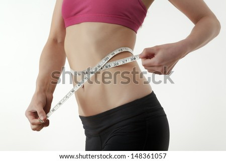 happy woman with thumbs up in a sports bra looking happy