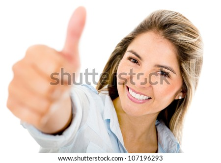 Happy woman with thumbs up - isolated over a white background