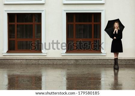 Stock Photo Happy woman with umbrella in the rain
