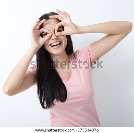 Happy woman with white perfect smile looking at camera in studio on white #573534376