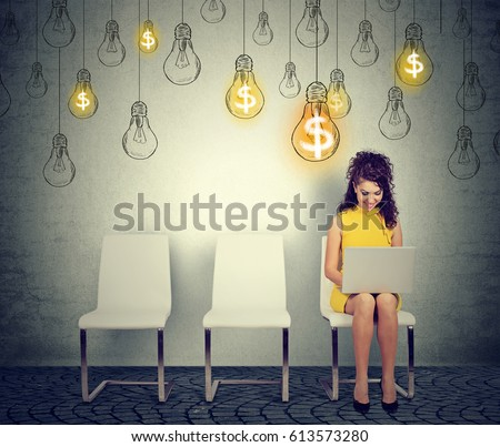 Happy woman working on laptop building successful online business. Internet technology and finances concept