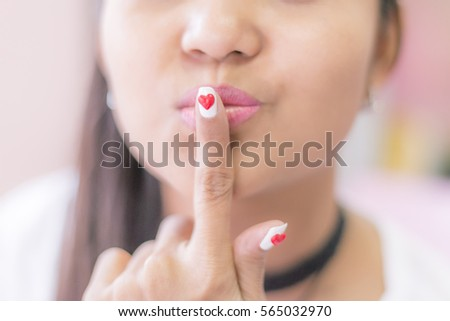 Happy women finger nails painted red heart shape, Valentine concept, Valentine theme #565032970