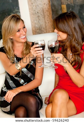 Happy women in a bar having a drink and toasting