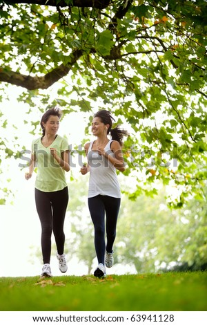 Happy women jogging at the park fitness concepts