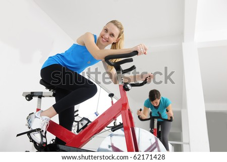happy women on bike at the gym