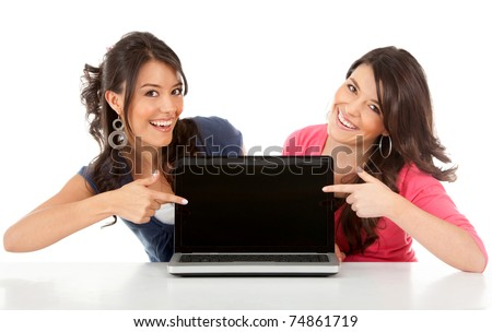 Happy women pointing at a laptop computer screen? isolated over white