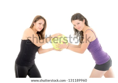 Happy women pulling a ball