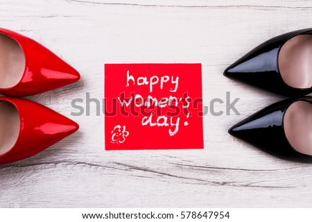 Happy Women`s Day greeting card. Greeting card between shoes. New shoes as present. Holiday for women. #578647954