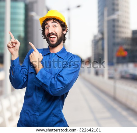 happy worker man pointing up