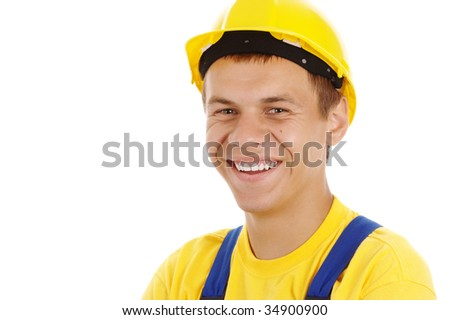 Happy worker wearing hard hat and blue-and-yellow uniform, isolated over white