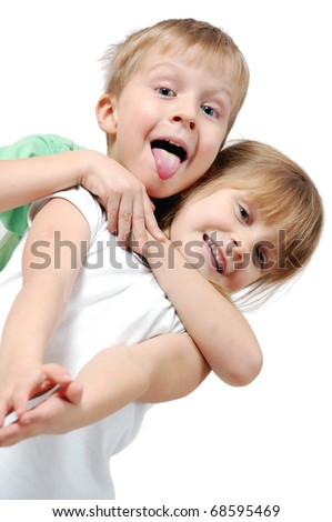 happy 5 year old girl and boy over white background - stock photo