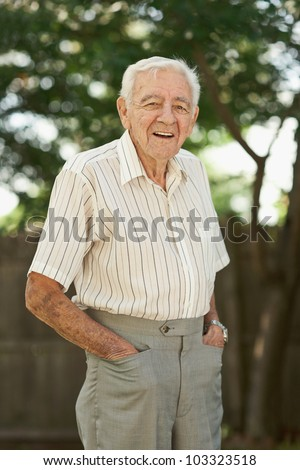 Happy 90 year old senior man standing outside