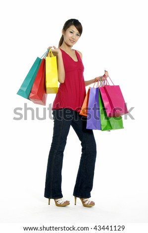 happy young adult girl with colored bags