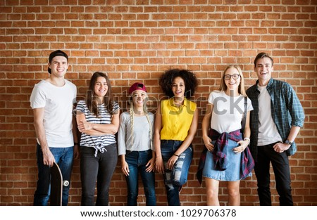 Happy young adult group of friends youth culture concept