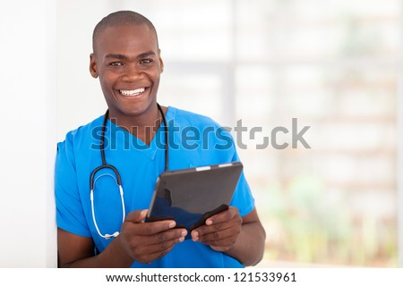 happy young african american health care worker with tablet computer