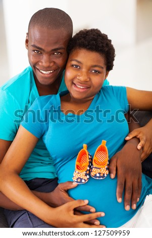 happy young african american parents to be at home