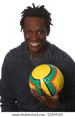 Happy young African man with a yellow soccer ball