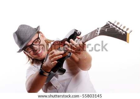 happy young and attractive man with guitar
