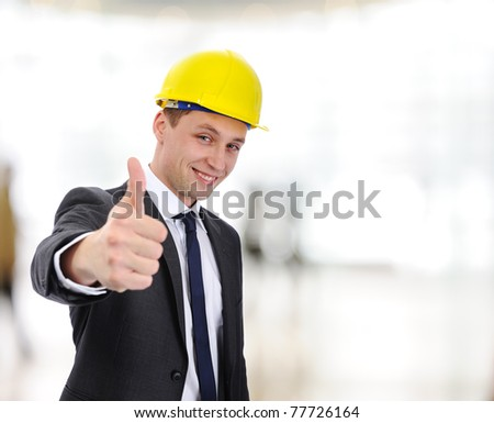 Happy young  architect with thumb up indoor