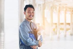 Happy Young Asian Engineer Smiling, Looking at camera.