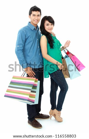 happy young asian woman and man shopping