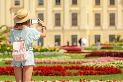 Happy young asian woman travel in Schoenbrunn royal palace garden. Travel and tourism in Vienna and Austria