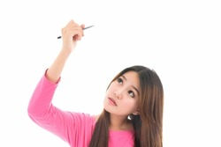 Happy young  Asian woman writing or drawing something on screen,concept positive emotions and facial expression,portrait of beautiful Asian woman,isolated on white background