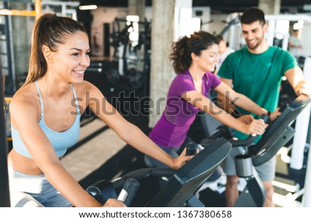 Happy young athlete woman feeling determined on a exercising class in a gym